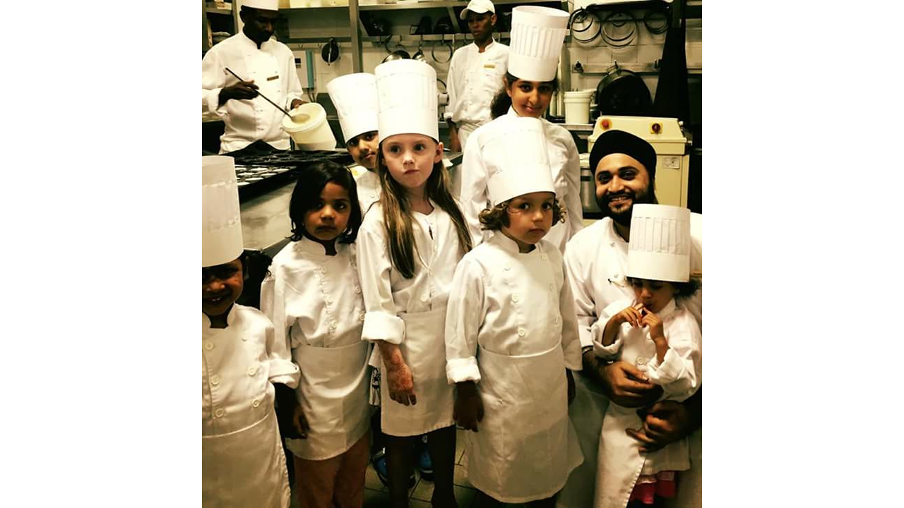 Damanraj with kid chefs.