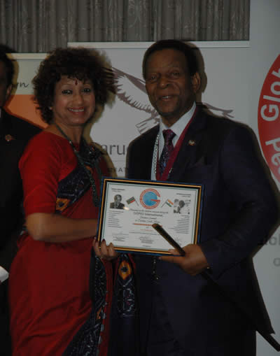 Receiving Achievement Award from the hand of the King  of the Zulu Nation King Gppdwill Zwelithini Ka Bhekuzulu.