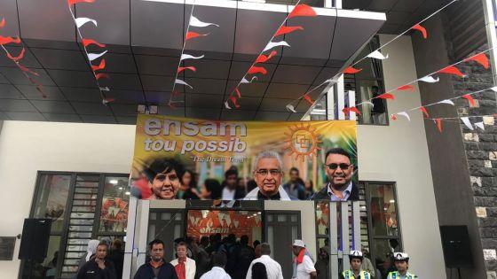 Petit-Verger : distribution de t-shirts orange avant l'arrivée des candidats de l'Alliance Morisien