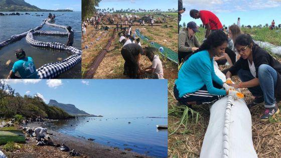[En images] Mobilisation pour faire barrage à une éventuelle remontée de la nappe de mazout à l'île-aux-Cerfs