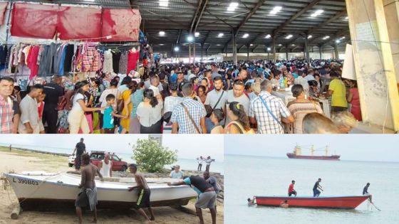 [En images] Alerte cyclonique 2 : des Mauriciens font des emplettes ; des pêcheurs amarrent leurs bateaux
