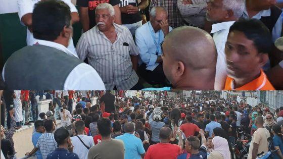 No 3 : chahuté par la foule, Anwar Husnoo escorté vers une salle de classe sous protection policière