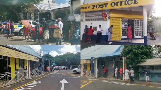 Reprise partielle des activités : file d'attente devant les bureaux de poste