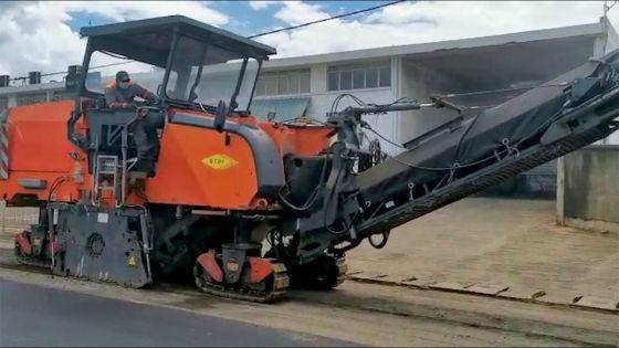 Reprise partielle des activités : les travaux d'asphaltage à Petite-Rivière reprennent