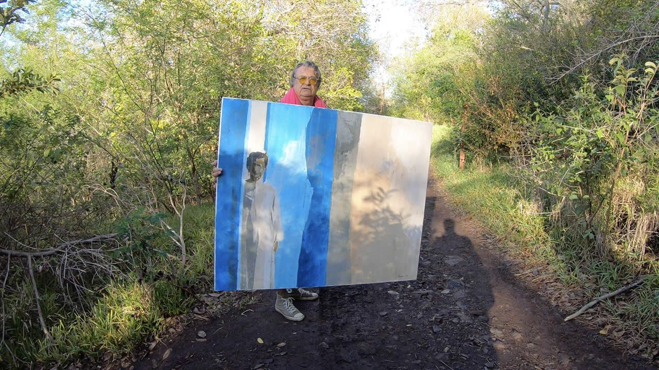 Francis Chapus, ascension du Morne avec son tableau.