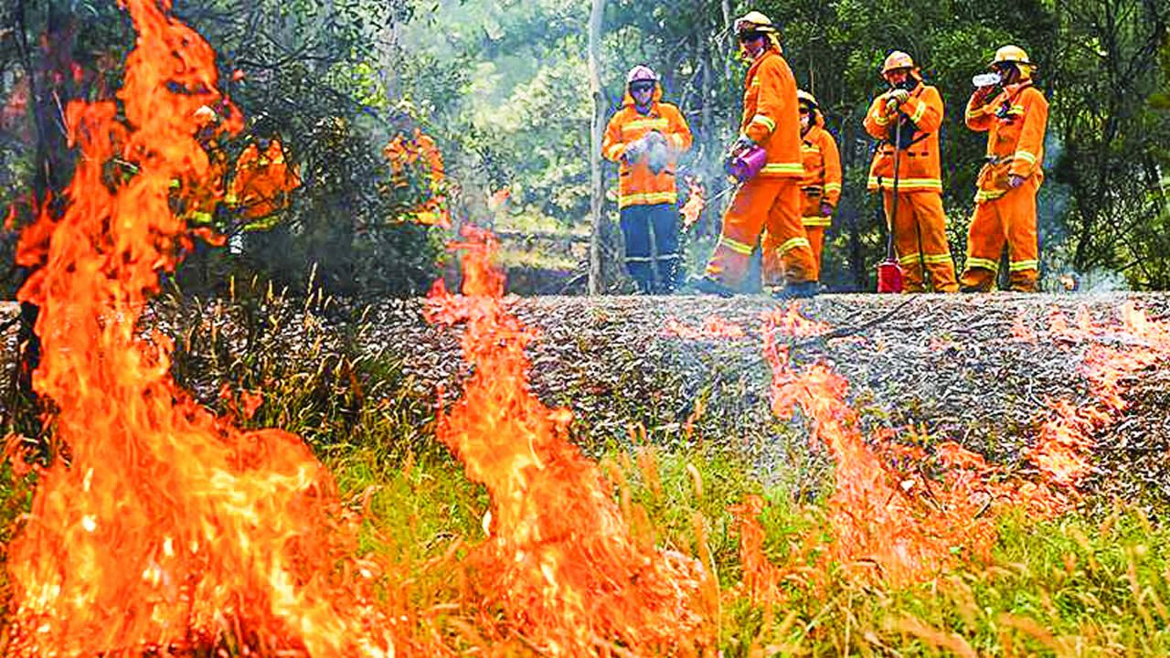 Australians are being urged to evacuate as giant fires threaten to regenerate with high winds  and hot temperatures.